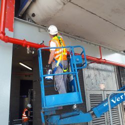 Man in High Vis on Cherry Picker Doing Maintenance